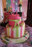 Topsy Turvy Fondant Cake - Candy Themed Cake with fondant bow.